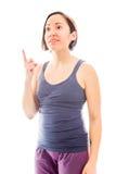 指向她的手指的少妇  免版税库存图片