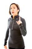 指向她的手指的少妇  免版税库存照片