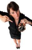指向妇女的闹钟 免版税库存图片