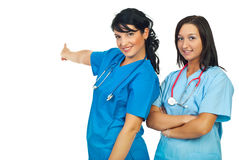 指向小组妇女的医生 免版税库存照片