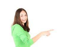 指向少年年轻人的手指女孩 免版税库存图片
