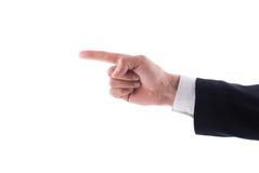 指向左食指的商人手 免版税库存图片