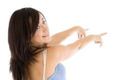 指向年轻人的女孩 免版税库存图片