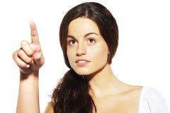 指向年轻人的手指女孩 免版税库存图片