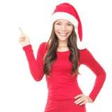 指向微笑妇女的圣诞老人 免版税库存图片
