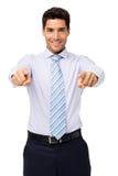 指向您的愉快的年轻商人 库存照片
