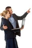 指向成功的企业的夫妇  免版税库存照片