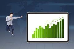 指向成长图表的商人 库存图片