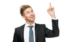 指向手势的商人画象 免版税图库摄影