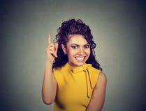 指向手指的妇女有一个精采想法 图库摄影