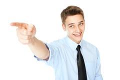 指向手指的年轻商人 免版税库存图片