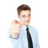 指向手指的年轻微笑的商人隔绝在白色 库存照片