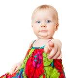 指向手指的滑稽的女婴 免版税库存照片