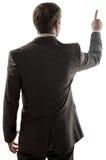 指向拷贝空间的商人背面图 免版税图库摄影