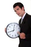 指向时钟的人 免版税库存图片