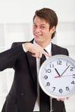 指向时间的生意人 库存图片