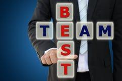 指向最佳的队概念的企业手 库存图片