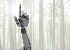 指向有明亮的森林背景的机器人机器人手 免版税库存图片