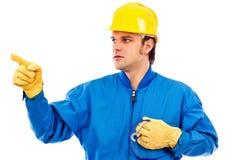 指向某事的一名新建筑工人的纵向 库存照片