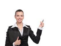 指向某事的女实业家画象 免版税库存图片