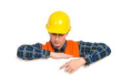 指向横幅的建筑工人。 库存照片