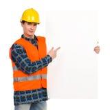 指向横幅的建筑工人。 免版税库存照片