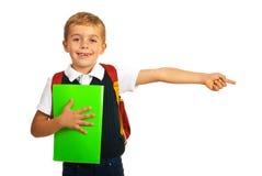 指向正确的部分的男小学生 免版税图库摄影