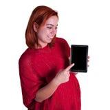 指向片剂屏幕的女孩 库存照片
