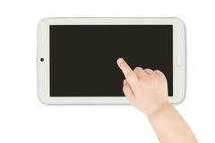 指向白色片剂计算机的婴孩手 库存照片