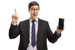 指向的商人拿着电话和  库存图片