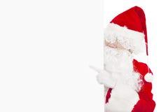 指向空白的横幅的圣诞老人 免版税库存照片