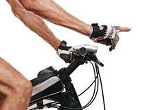 指向自行车骑士的手 免版税库存照片