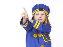 指向警察年轻人的服装女孩 免版税库存照片