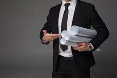 指向计划的大师建造者胳膊 免版税图库摄影