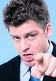 指向他的手指的激动的商人 免版税库存照片