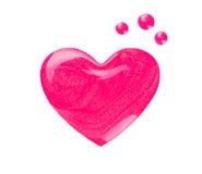 指甲油污点或滴水以心脏的形式在白色 免版税图库摄影