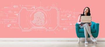 指纹与使用膝上型计算机的妇女的扫描题材 库存图片