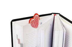 按书签在一个笔记本为华伦泰` s天 库存照片