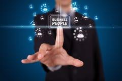 按按钮的现代企业类型生意人 图库摄影