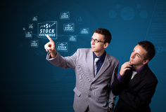 按按钮的现代企业类型生意人 库存照片