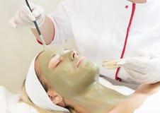 按摩和脸面护理处理化妆面具  库存照片