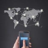 按有全球网络的手指一个智能手机 图库摄影