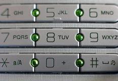 按移动电话 免版税库存图片