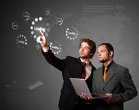 按简单的启动类型的生意人按钮 免版税库存图片