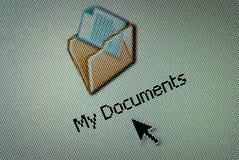 按钮接近的计算机文件夹 图库摄影