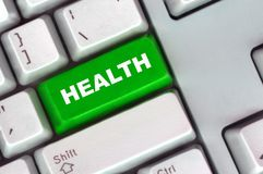 按钮绿色健康关键董事会 图库摄影