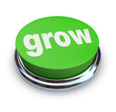 按钮绿色增长 库存照片