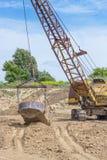 挖掘在黏土的发展砖生产的 库存照片