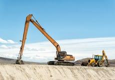 挖掘机和反向铲 库存照片