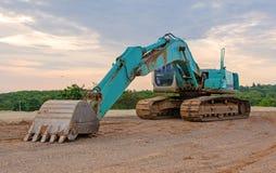 挖掘机工地的建筑器材公园 免版税库存照片